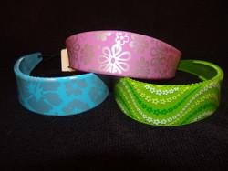 serres têtes silicone - serres têtes de couleurs et motifs variés - EMMANUELLE COIFFURE - Voir en grand